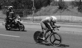 Time trial bike followed by motorbike