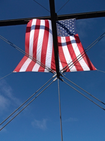 A US flag decorates the Folsom pedestrian bridge