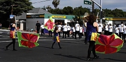 Flag wavers in Pow Wow Days parade